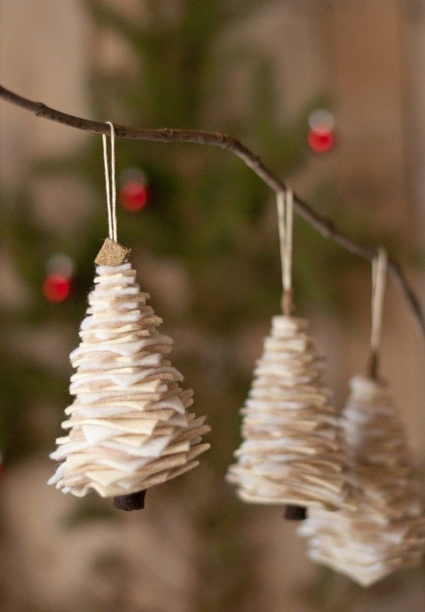christmas diy making and then han making and then hanging these adorable felt trees is an easy craft for the
