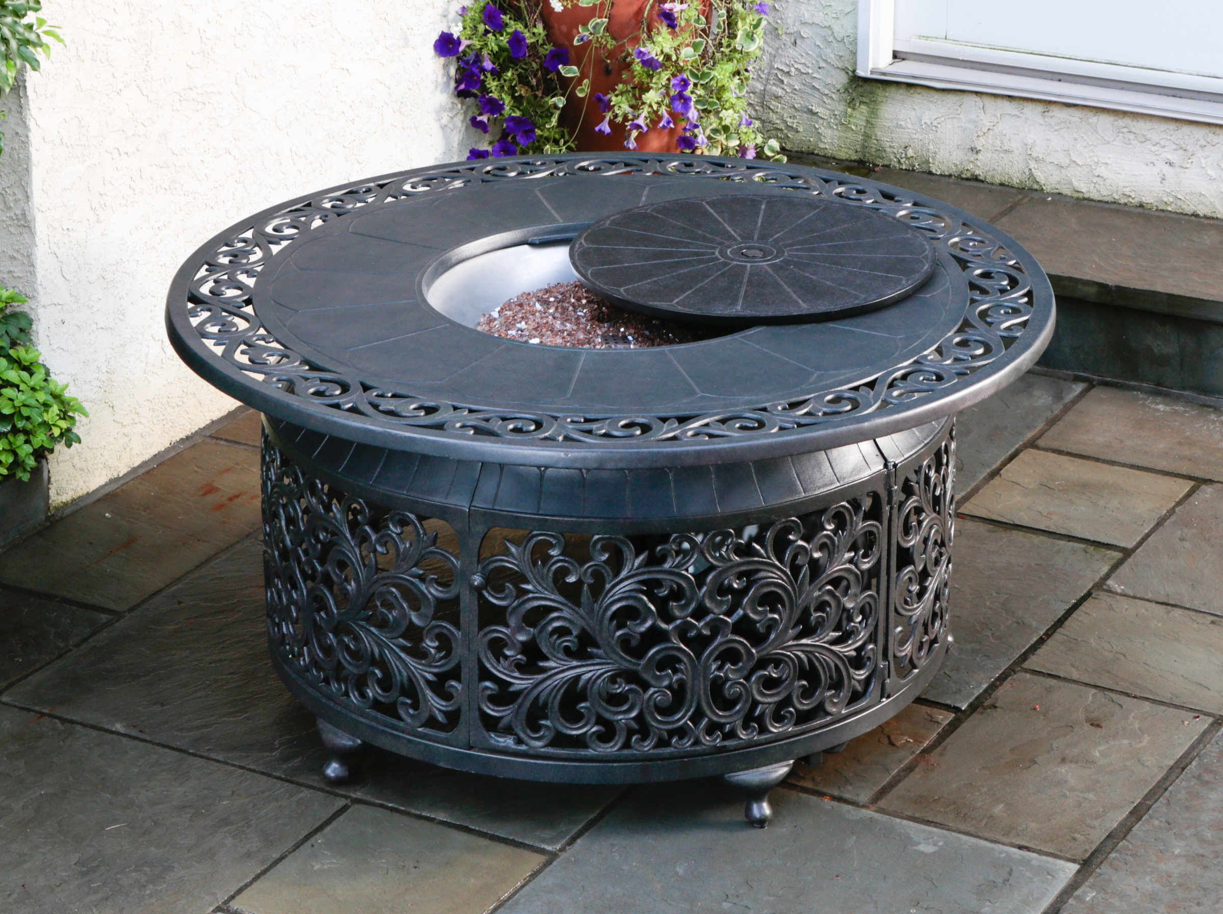 this fire pit is powered by a propane tank that is hidden in the base