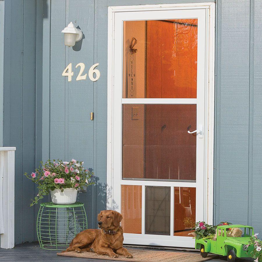 This Door Features A Factory Installed Flexible Pet Flap With 10 In X 17 In Opening Allows Pets Up To 100 L Storm Door Aluminum Storm Doors Larson Storm Doors