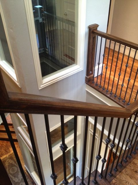 Glass Home Elevator In The Middle Of A Winding Staircase