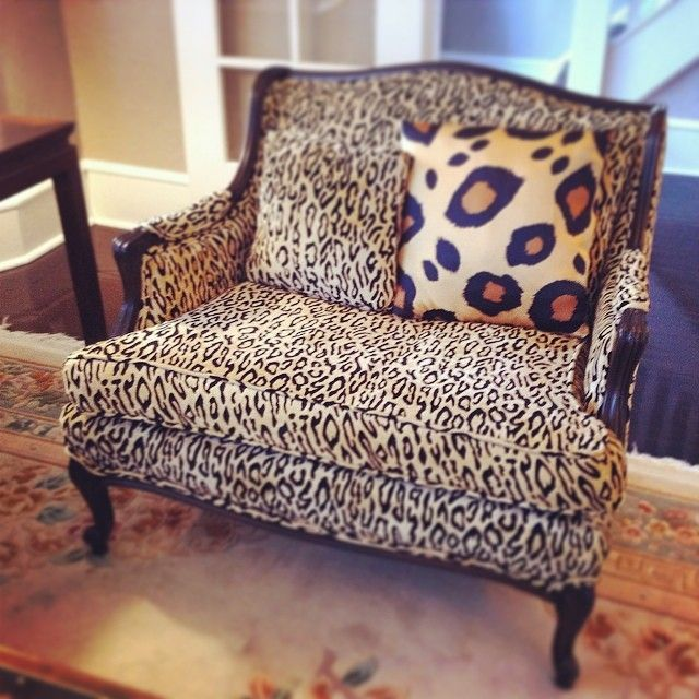 Cheetah Print Settee With A Larger Scale Leopard Print Pillow