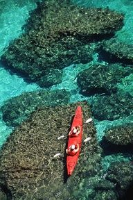 Kayakers in clear blue water off the shore of San Jose Island - Baja, Mexico