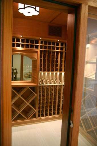 Through the looking glass- A small wine room with plenty of storage for all of your bottles, trimmed with handmade touches no matter the size we can build something to match your individual style and tastes. longislandwinecellars.com
