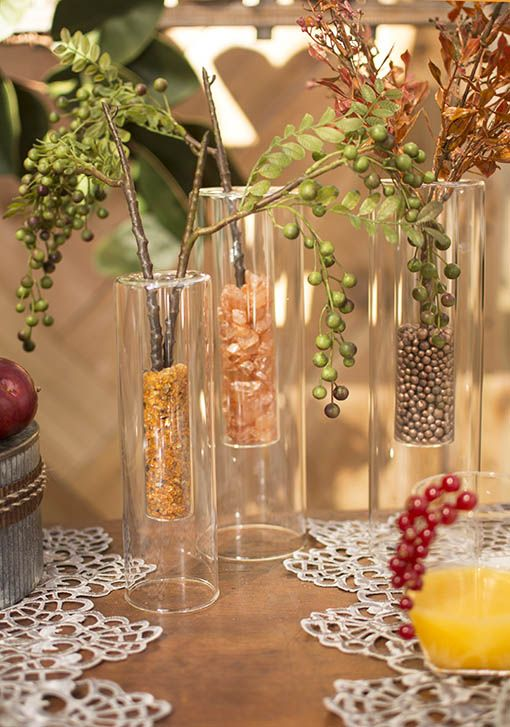 For a modern, inviting table, combine our double-walled clear glass vases  with