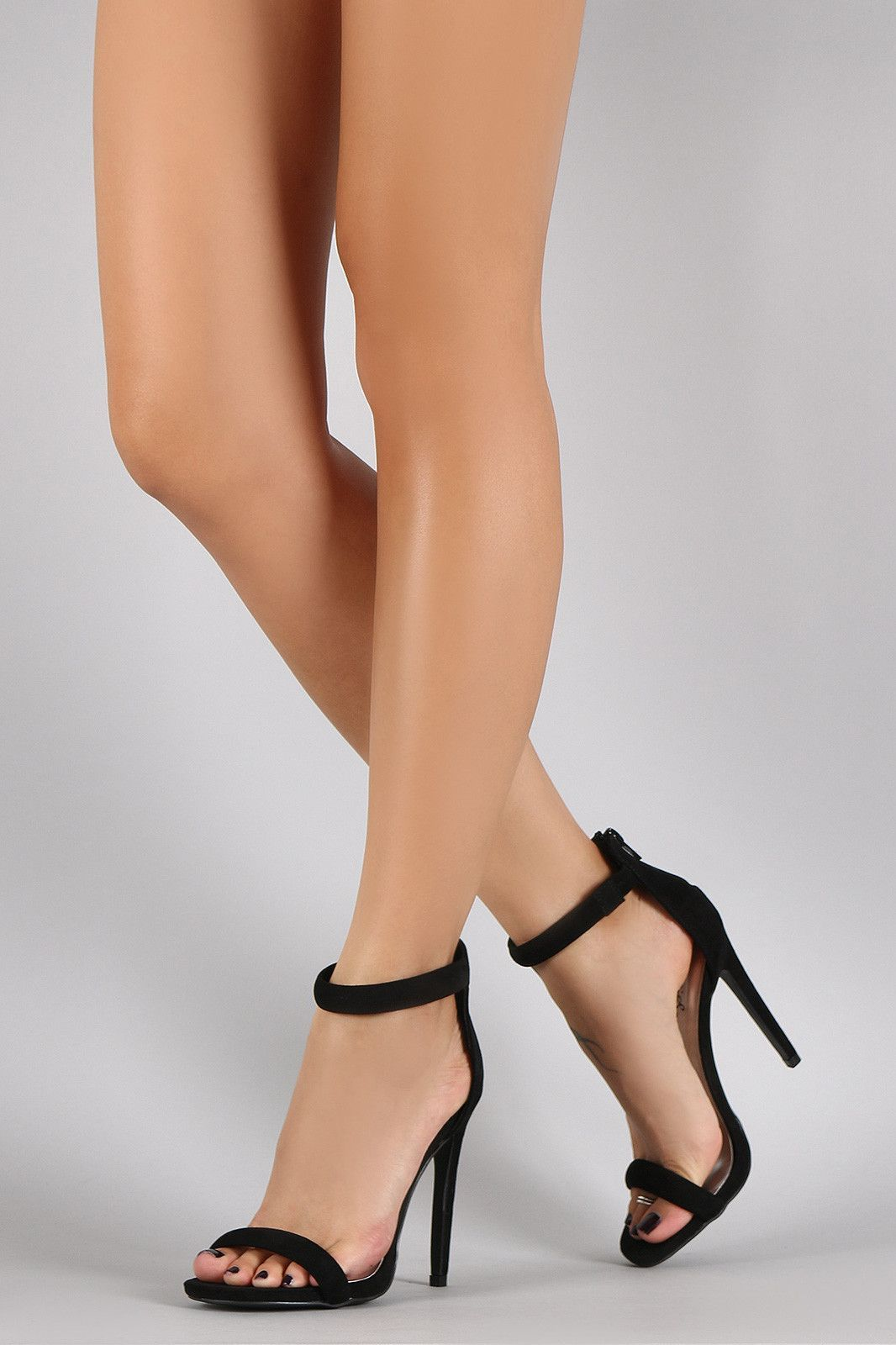 0c72f4ffd780 Description This is a classic open toe heel   featuring a single strap vamp  and an ankle strap. Rear back adjustable zipper closure.
