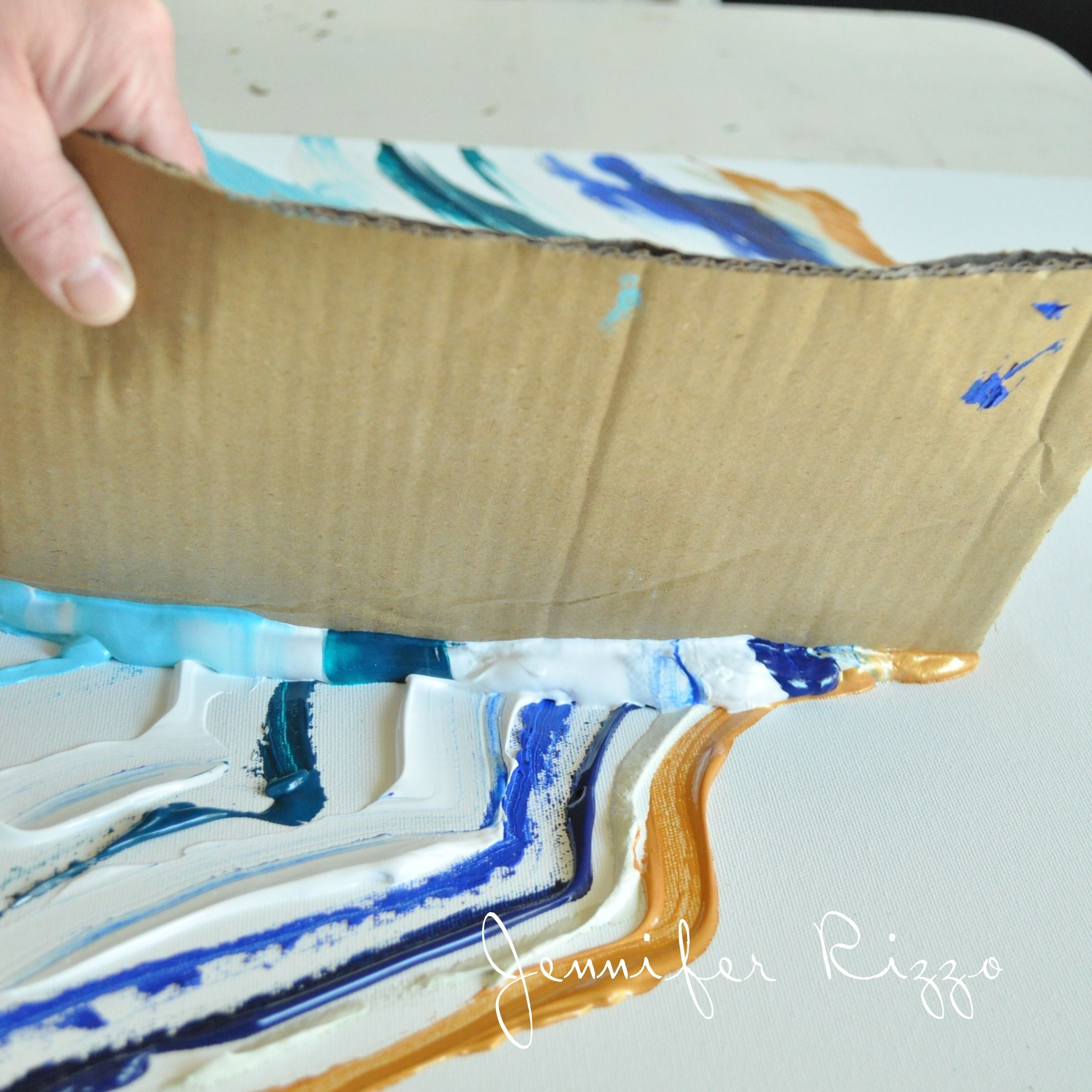 Drag your cardboard across the paint for an agate pattern for Diy abstract acrylic painting