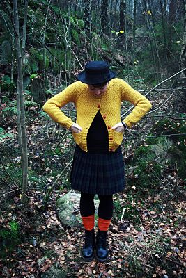 A bright yellow cardigan with red buttons is a must!