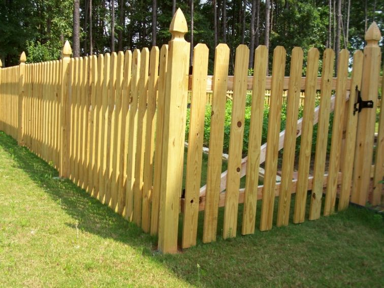 Adorable Wooden Picket Fence For The Backyard Garden. Design By Mossy Oak Fence  Company