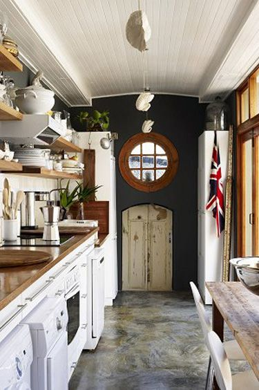 perfect galley kitchen.  Not an optimal layout but amped up positives like barrel ceiling, wicked focal point, and open shelving.  I likey