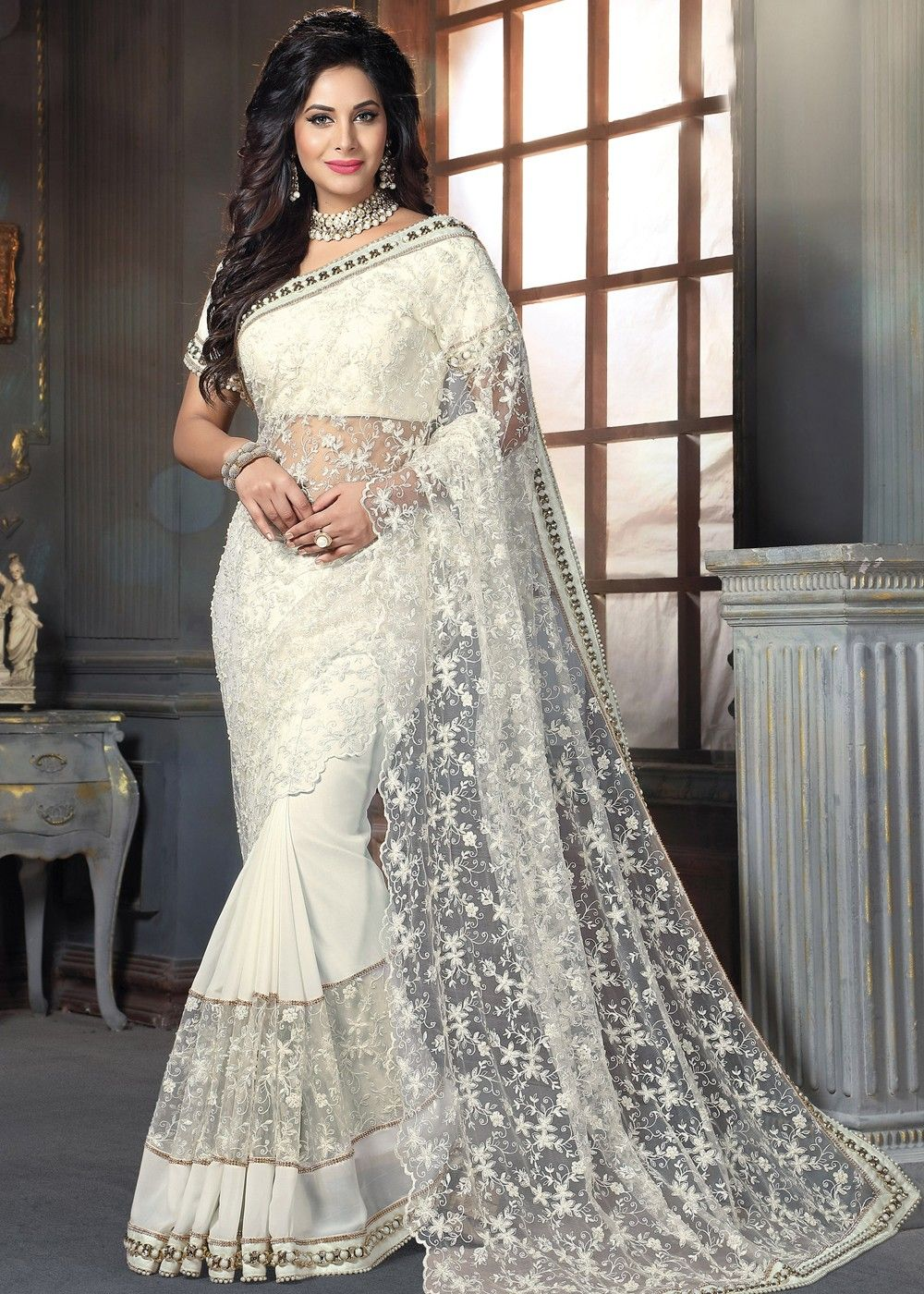 52aad2b1b3f80f Georgette and net saree in white with beautiful floral embroidery enhanced  by beaded lace throughout.