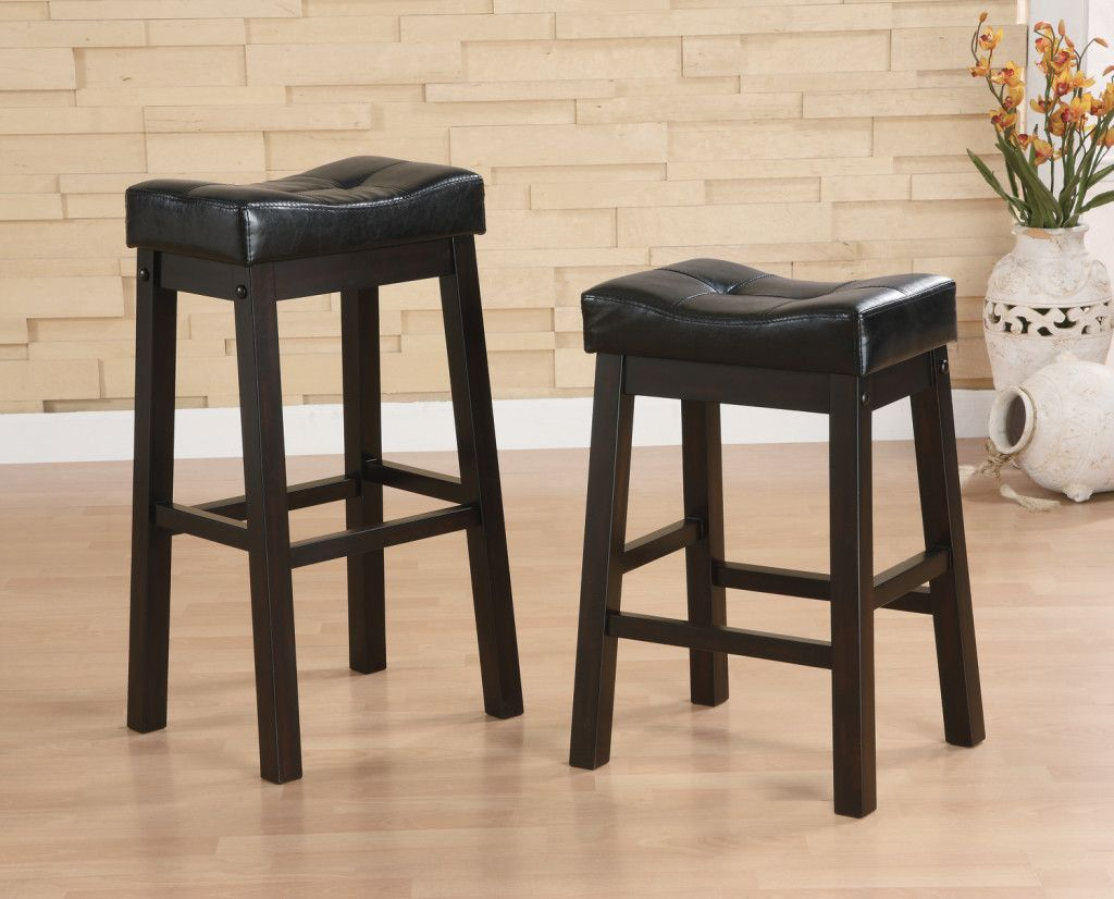 Breathtaking dark padded leather saddle bar stools idea in black with four wood legs idea
