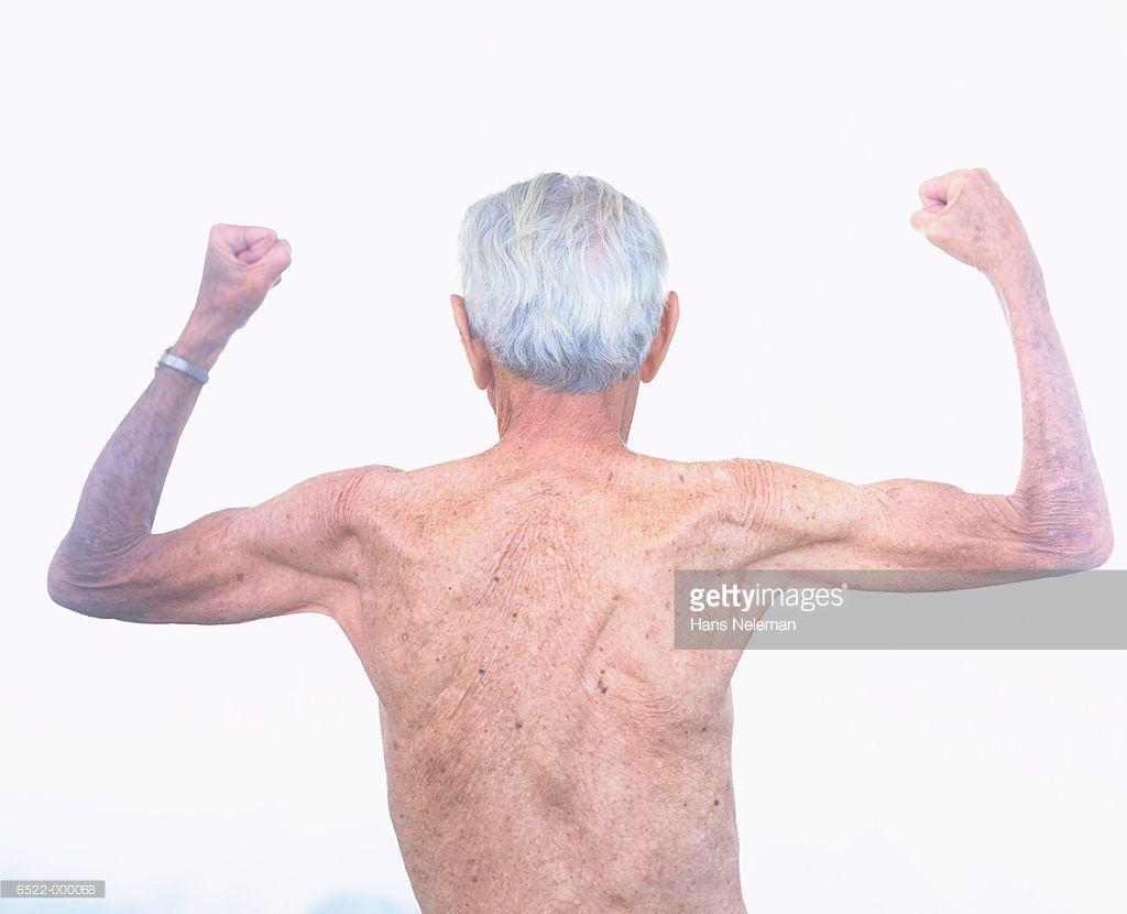 elderly man flexing muscles