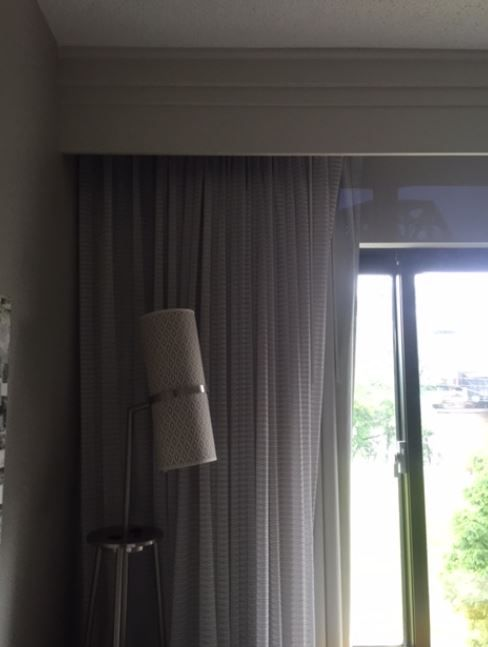 Eclipse curtains and sheers hung from ceiling mounted curtain tracks ...