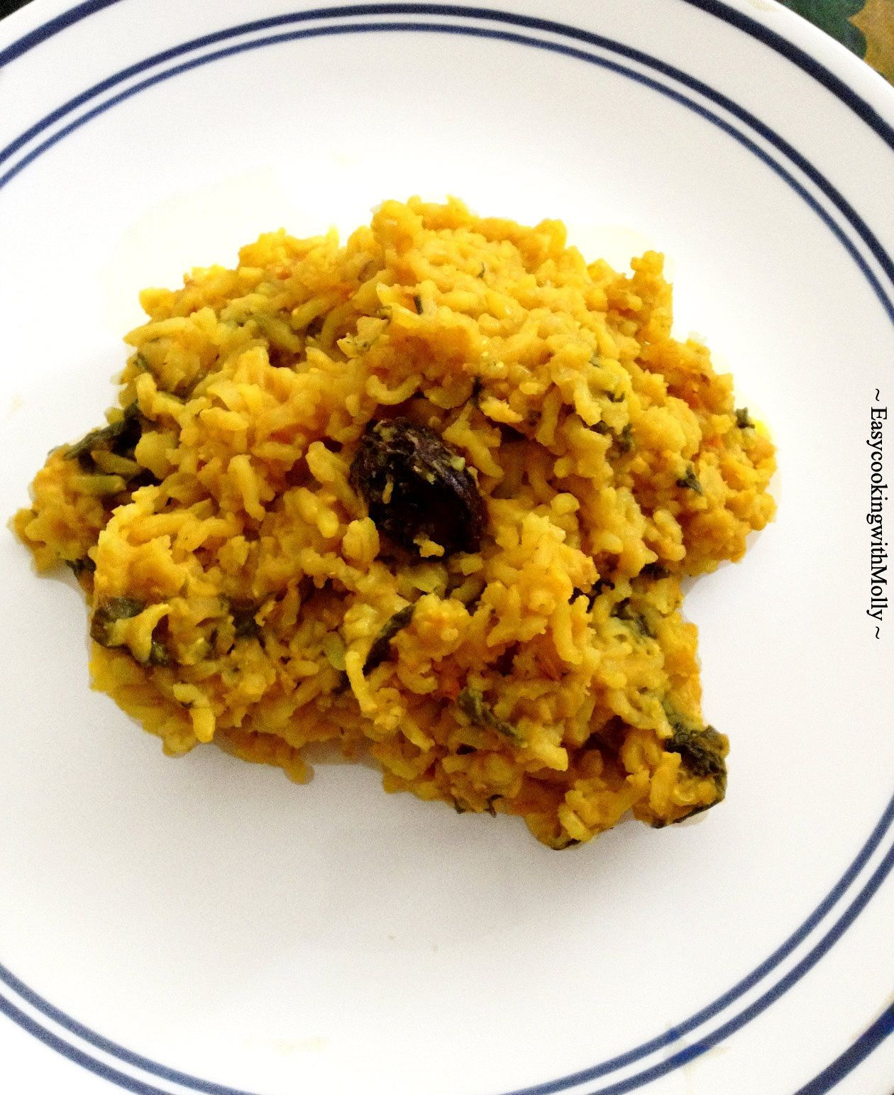 Khichuri is a mix of lentil and rice along with Indian