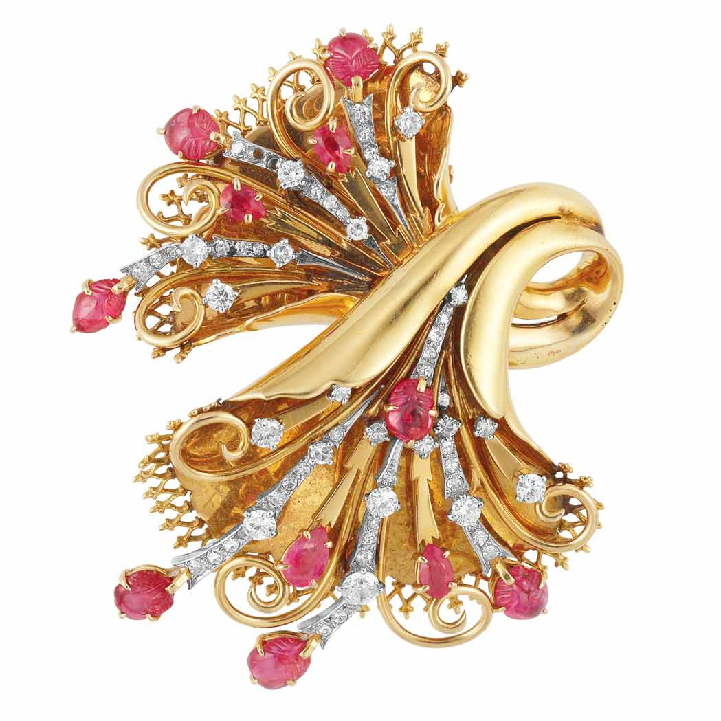 Retro Gold, Platinum, Ruby, Carved Ruby and Diamond Clip, France   18 kt., the polished gold stylized bow accented by diamond-set bands, embellished by 7 carved and 4 pear-shaped rubies, with maker's mark and French assay marks, circa 1940, 2 small diamonds missing, approximately 22 dwt.