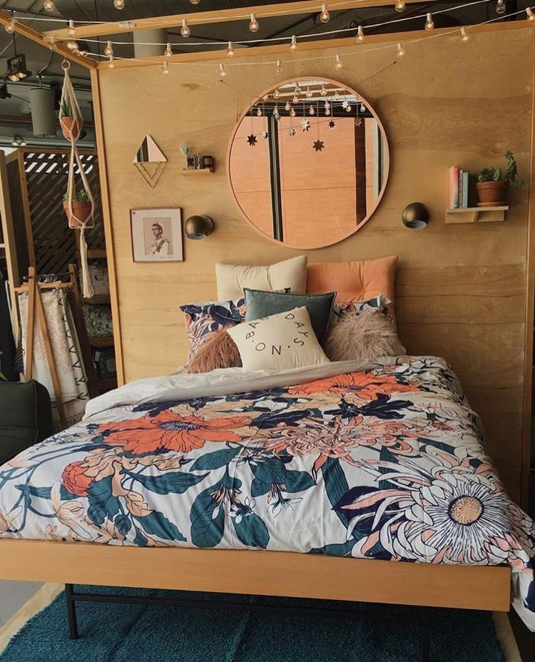 Boho Bedroom With Orange And Navy Blue Fl Bedding Rose Gold Accents