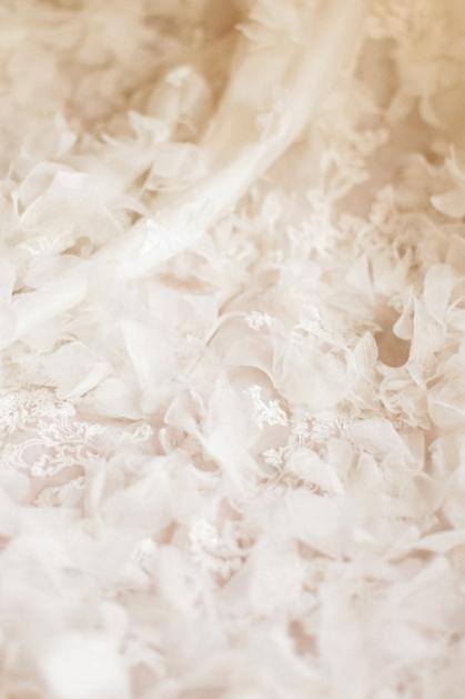 bride's dress ruffles feathers | xavier navarro