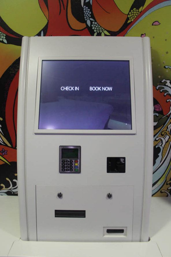 Self service check in machine features: card reader, room key