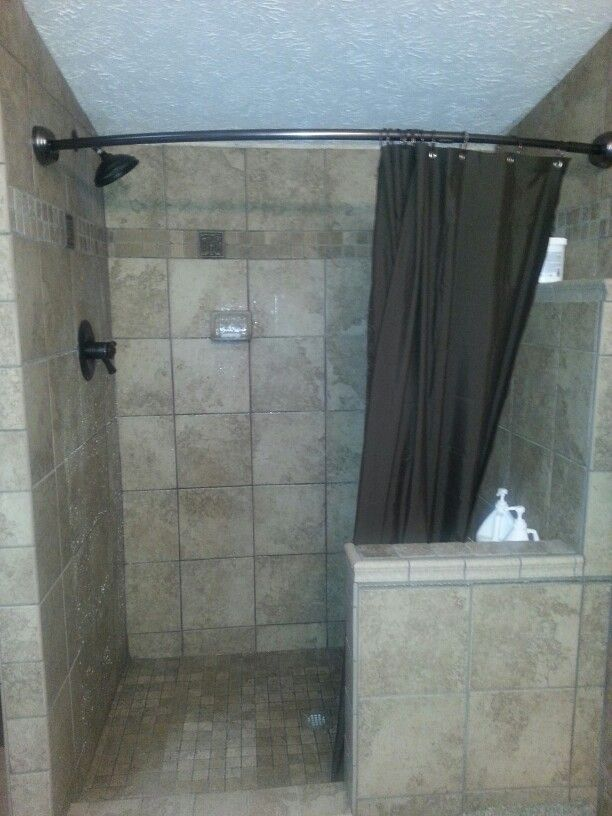 Tile Shower With Curved Curtain And Half Wall Plus Ledge For Shampoo Instead Of Recessed Storage