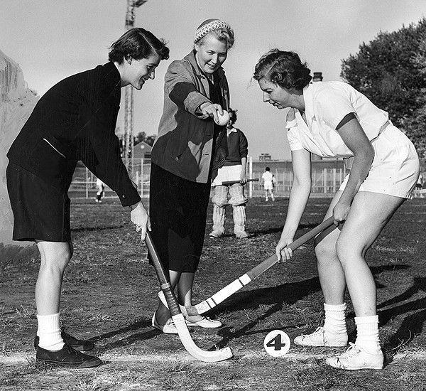 Julia Langsam ceremonially opens the 1955 intramural field hockey season at the University of Cincinnati