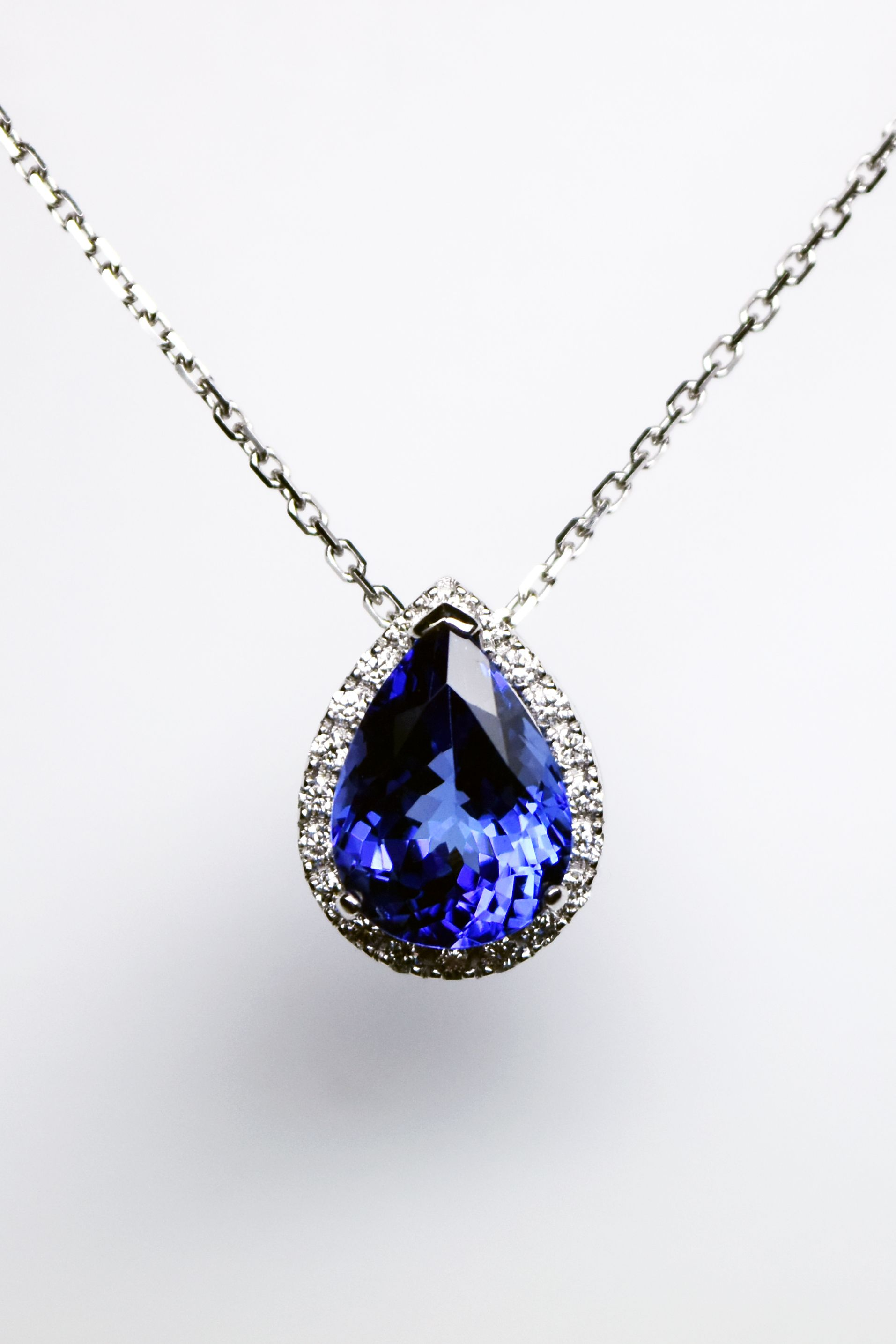 white gold oval necklace cluster pendant tanzanite diamond