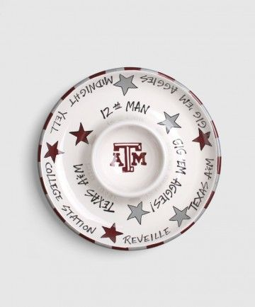 """Show off your Aggie pride at your next party with this handpainted glazed ceramic chip and dip bowl. Featuring a maroon and grey stripped border with stars inside the bowl. The bowl is lined with several Aggie phrases like """"Gog 'Em Aggies"""" """"Midnight Yell"""" and """"12th Man"""". The dip bowl is wide and deep, perfect for Mom's homemade salsa."""