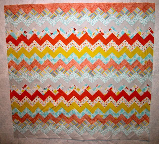 I've seen lots of different chevron quilt designs with many unique variations. When I was looking for a quilt pattern to use for my grandson's quilt, I decided I liked the simplicity of a chevron quil