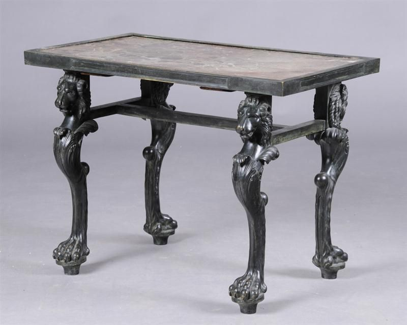 ITALIAN NEOCLASSICAL BRONZE AND MARBLE TABLE   In the Pompeiian manner, with an inset marble top within a paneled border, raised on lion monopodia supports. Provenance: Property from the Estate of George I Gravert. 26 1/4 x 35 1/4 x 21 in.