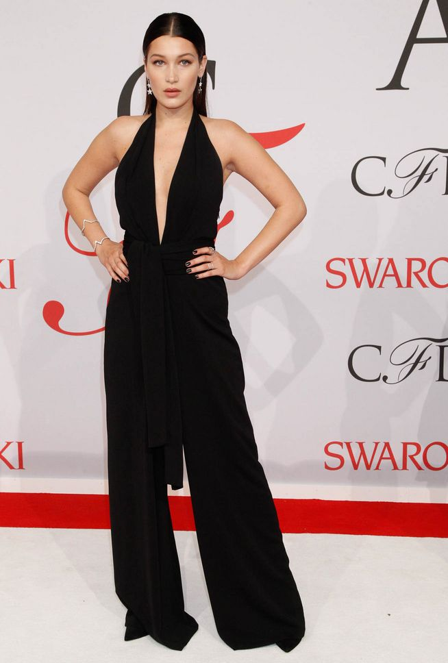 Trendy fashion style: Jumpsuit. Bella Hadid in 1970′s style halter ...