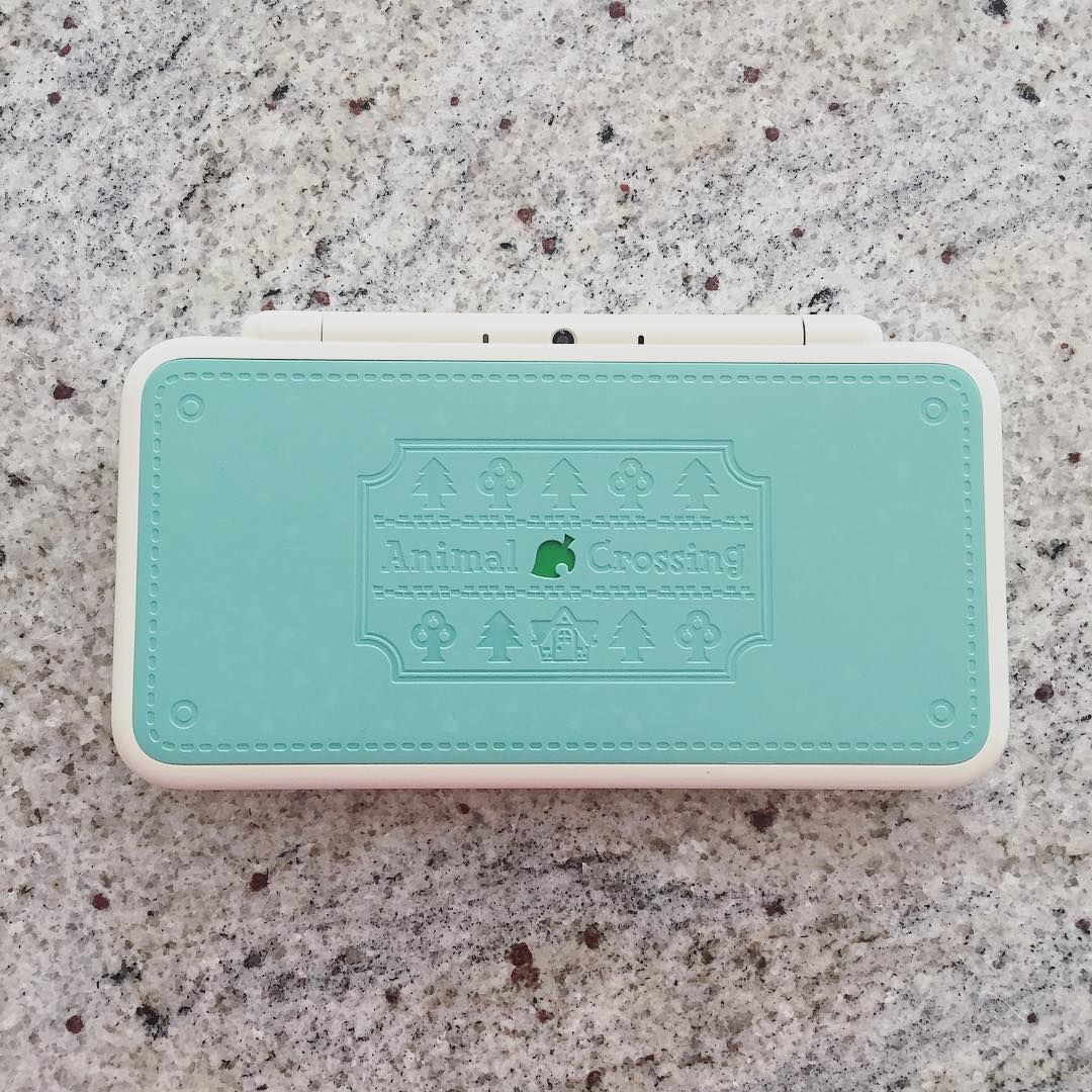 The New 2ds Xl Animal Crossing Edition Is So Beautiful The Details On The Console And The Color Scheme Are Perfect Animal Crossing Nintendo Classic Cute Games