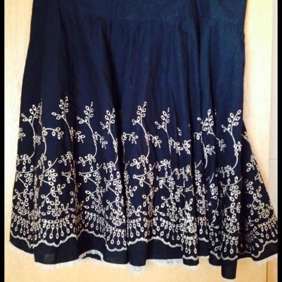 Flowy skirt with detail Beautiful black flowy skirt with tan embroidery detail on bottom Chris. tan Skirts