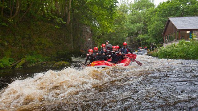 Group white water rafting on Tryweryn River, part of the National White Water Centre