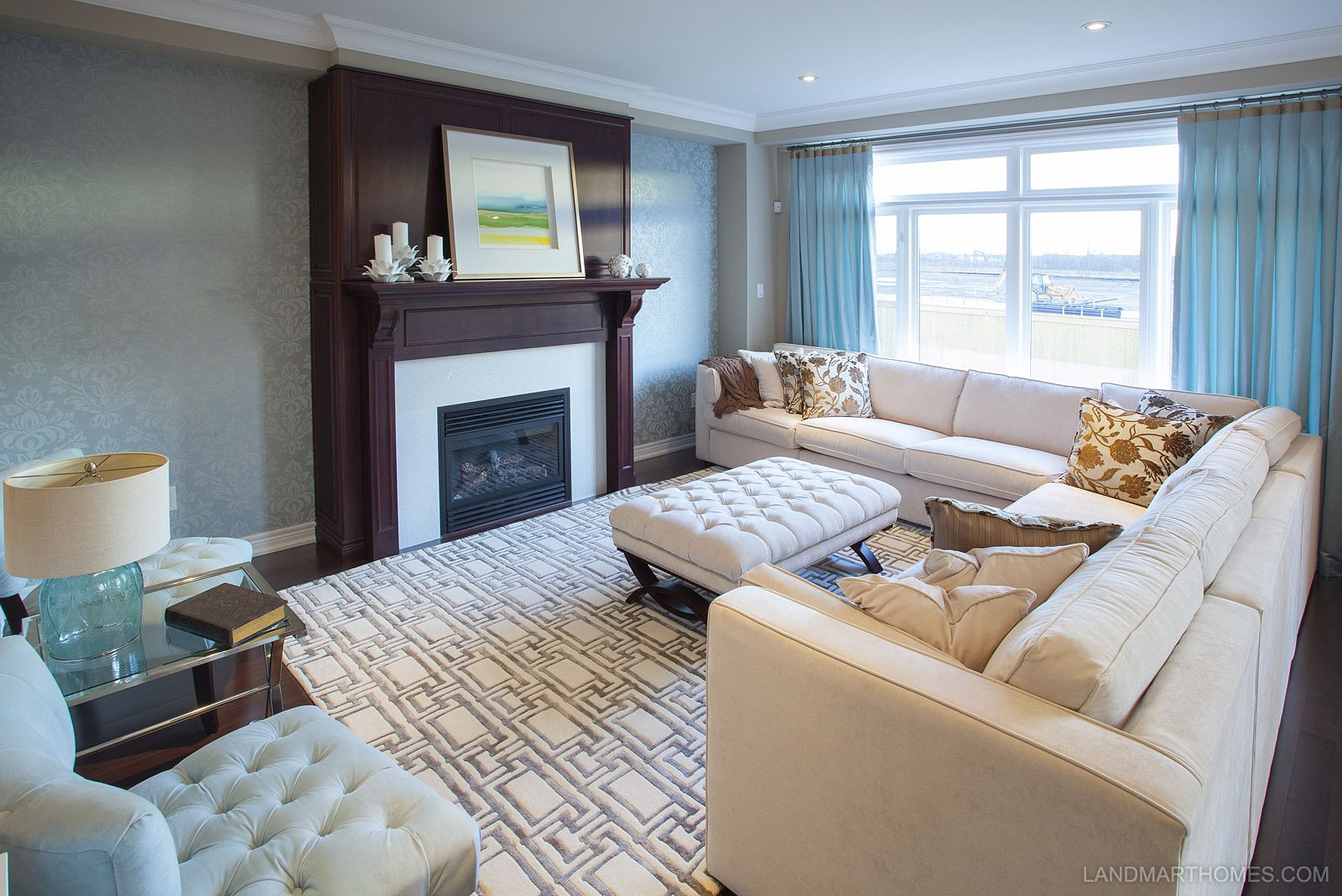 The warm colour pallet in this living room compliment the dark fireplace  mantle. Penny Lane