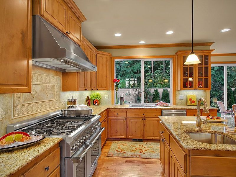 Giallo Ornamental Granite Countertops Pictures Cost Pros And Cons Honey Oak Cabinets Kitchen Remodel Light Oak Cabinets With Granite
