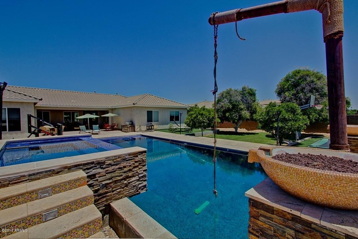 Backyard Ideas Fun Pool with rope swing. Backyard pool