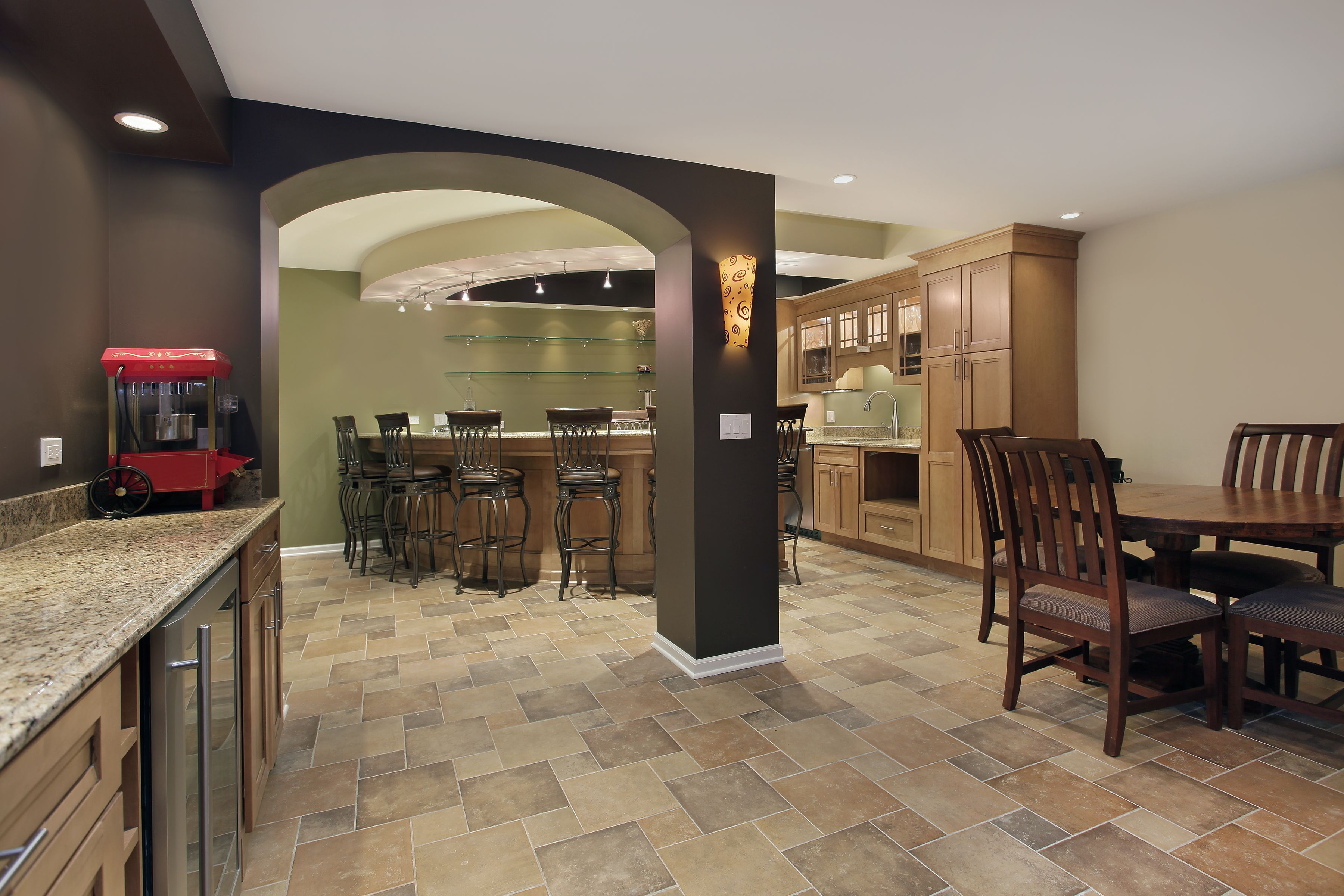 Gorgeous materials, lighting, and architectural details--but, where's the WoodTrac ceiling that would make this a perfect basement remodel?