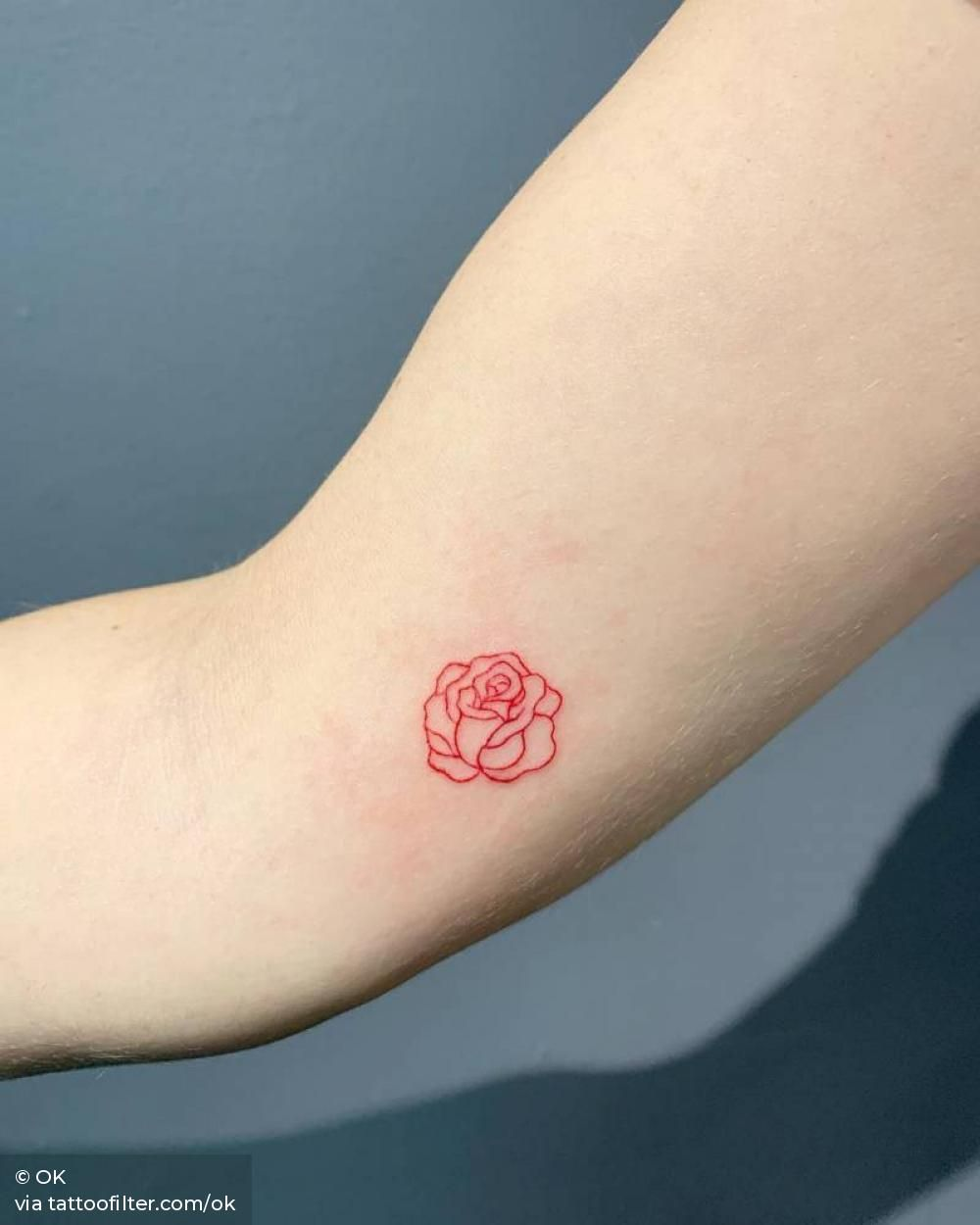 Red rose head tattoo.