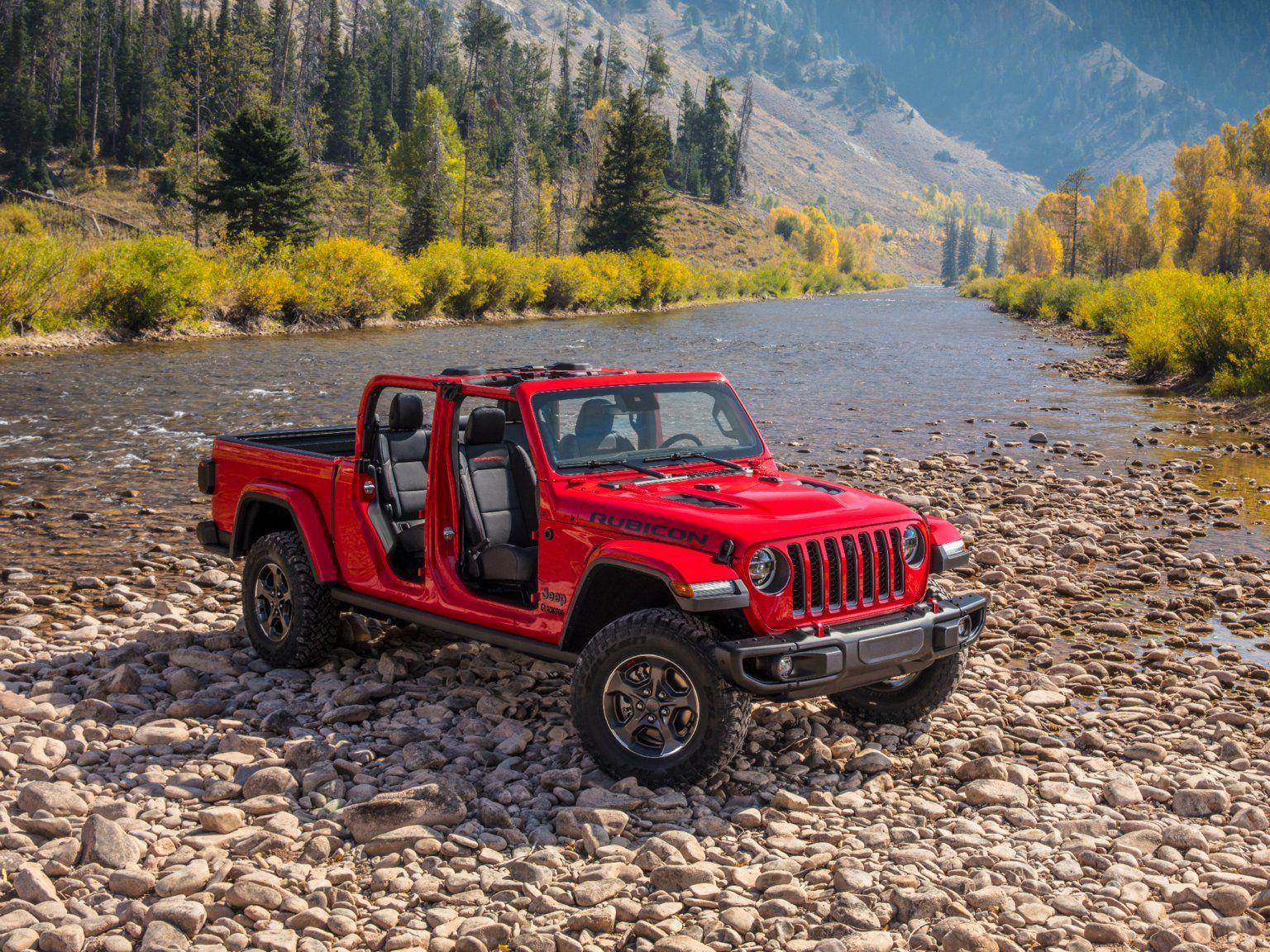Jeep Just Jumped Into The Pickup Truck Game To Take On Ford Chevy And Toyota With The Most Capable Midsize Truck Ever Jeep Gladiator Jeep Pickup Truck Jeep Pickup