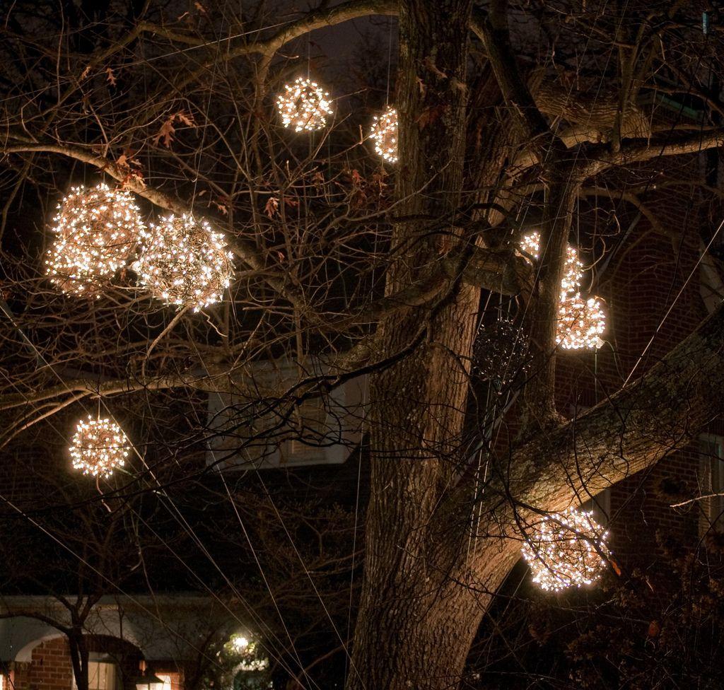 A street in Greensboro, NC make and hang huge lighted Christmas ...
