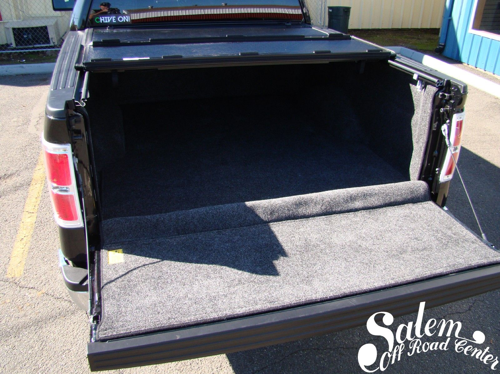 A 2013 Ford F150 with a Bed Rug bed liner and a