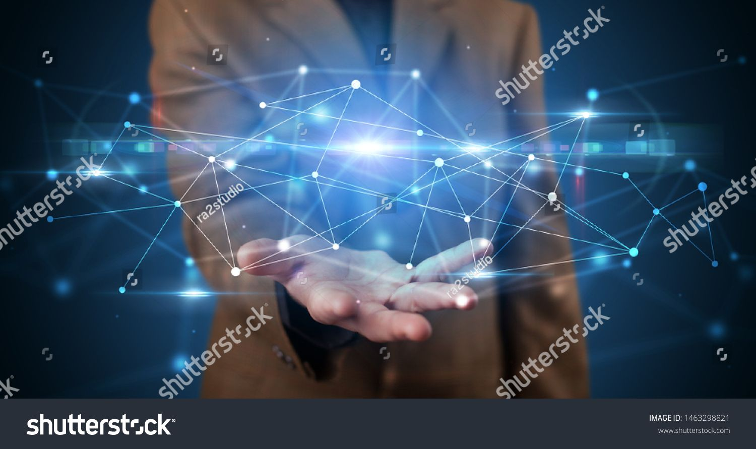 Handsome person holding hologram screen displaying modern