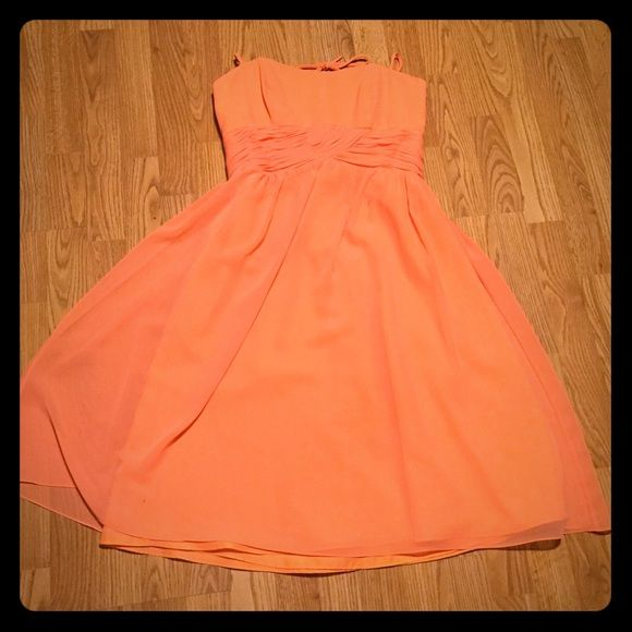 Alfred Angelo semi formal dress Straps around the neck, beautiful peach color. Size 10. So flattering and gorgeous with a tan. Small spot hardly visible as shown in photo. Alfred Angelo Dresses High Low