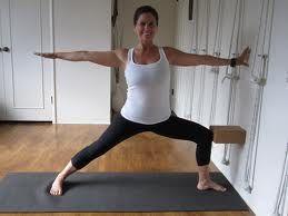 warrior 2 with block at wall  basic yoga poses basic