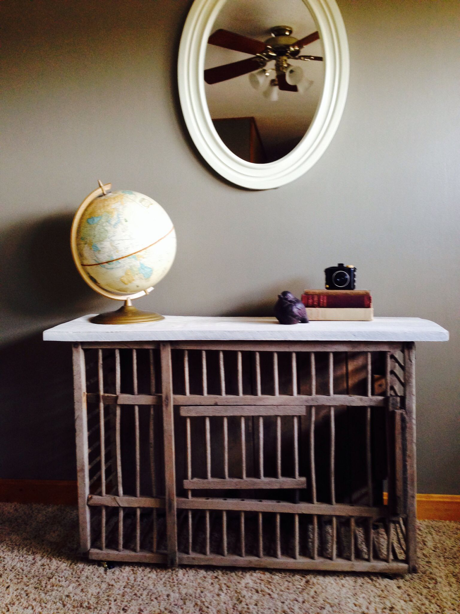 Antique chicken coop coffee table with vintage industrial wheels
