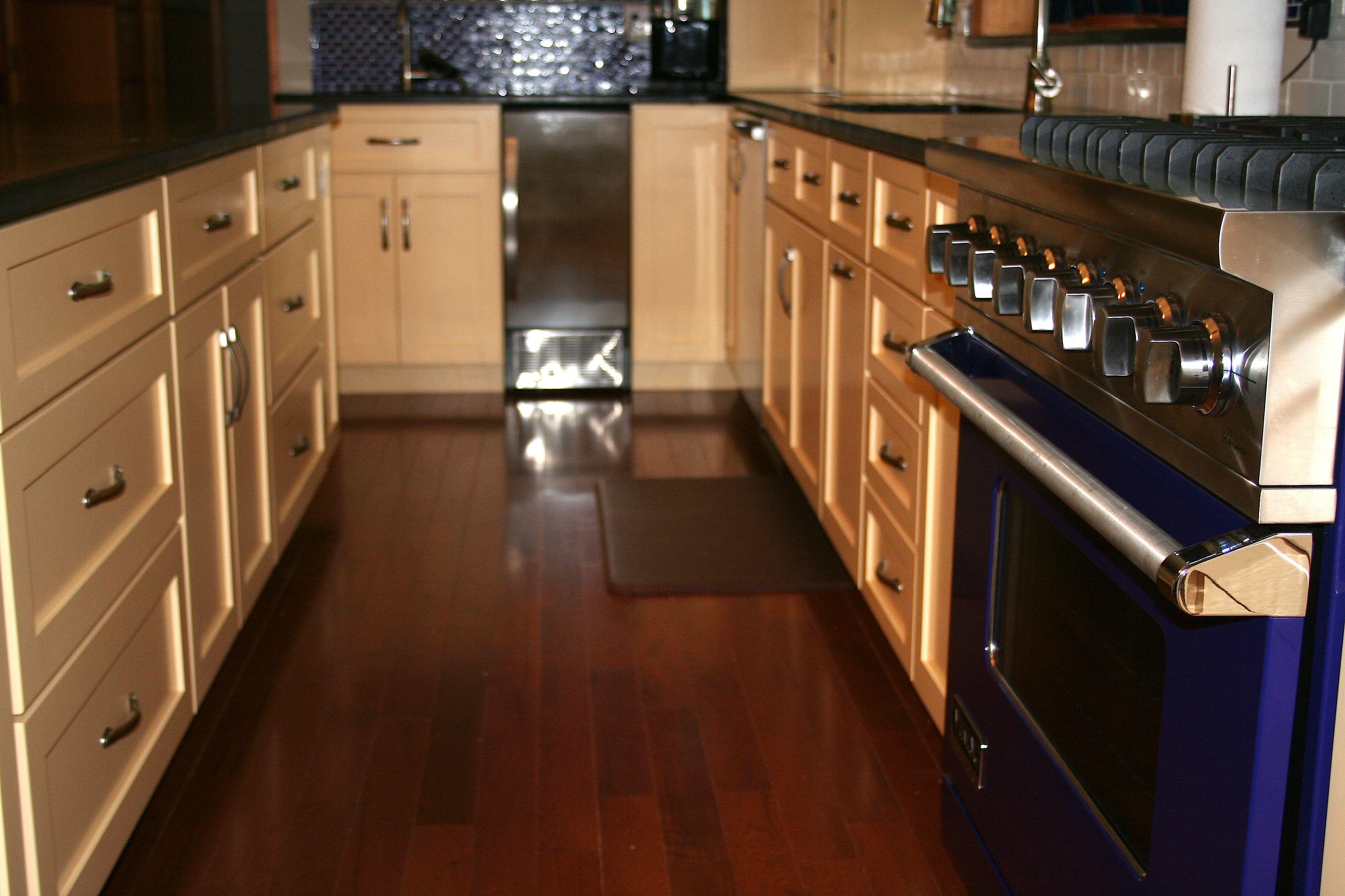 Blue Range And Buttercream Cabinets Create A Harmonious Tone In This Rhodeislandkitchen Kitchen Projects Kitchen S Kitchen