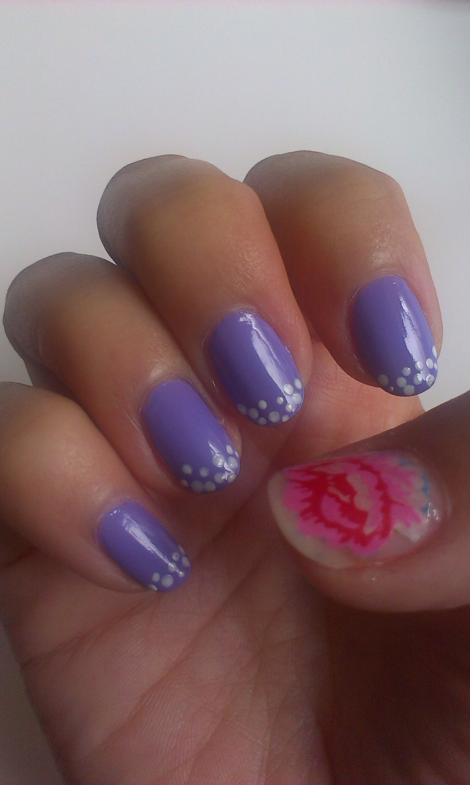 Spring nail design with a pink flower washi tape cut out on a clear ...
