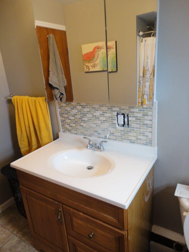 diy bathroom sink backsplash