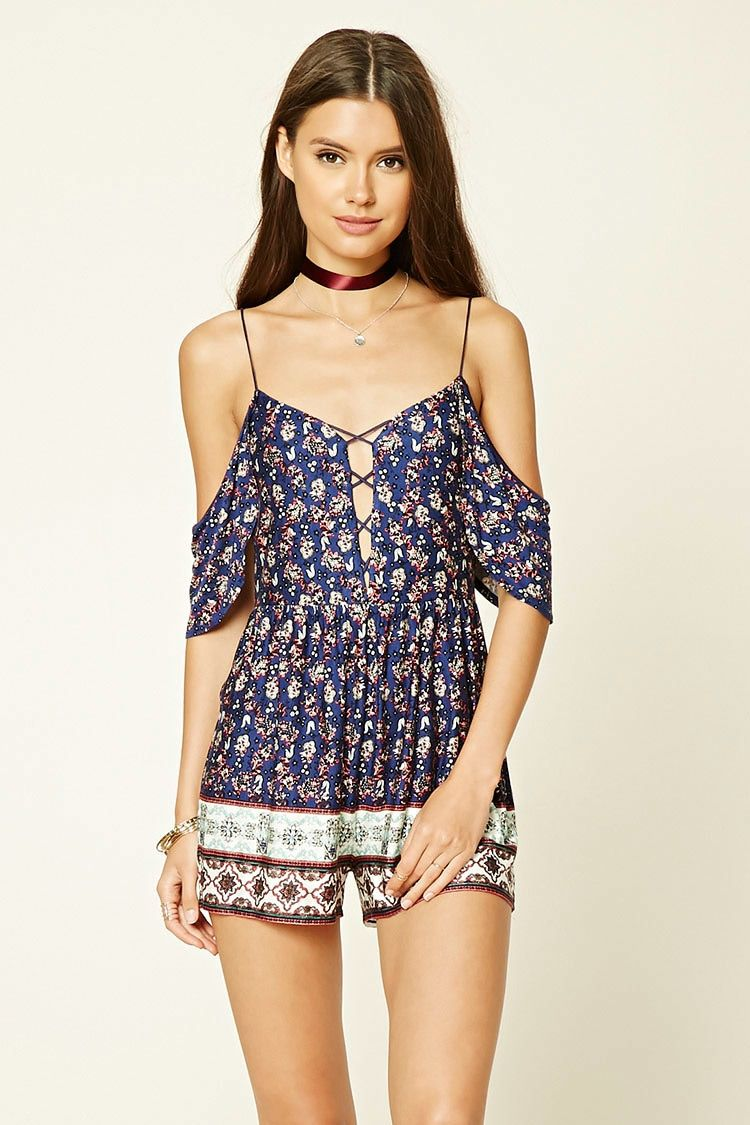 57c66806f91 A knit romper featuring an open shoulder