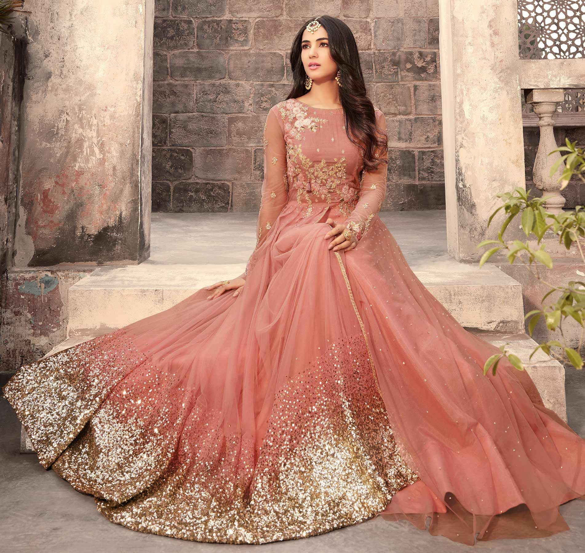Graceful Peach Colored Designer Embroidered Partywear Net