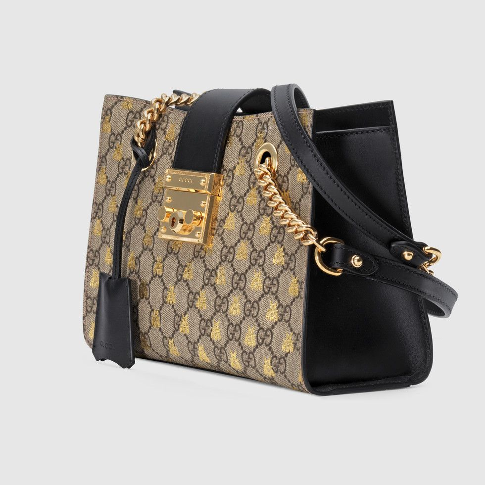 2f272c89a1ab Shop the Padlock small GG bees shoulder bag by Gucci. A structured shoulder  bag in the GG motif, enriched with allover gold printed bees—a historical  symbol ...
